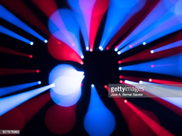 close-up unfocused of lights of colors in the shape of circles of colors blue and red on a black background. spain. - ディスコ照明 ストックフォトと画像