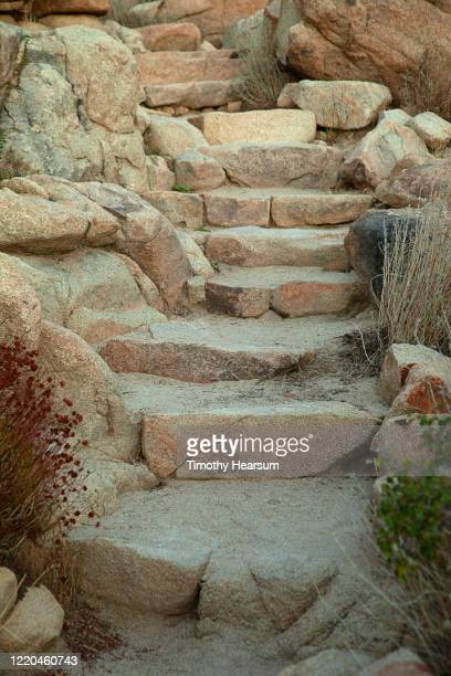 close-up vertical view of steps carved into boulders in joshua tree national park - timothy hearsum stock pictures, royalty-free photos & images