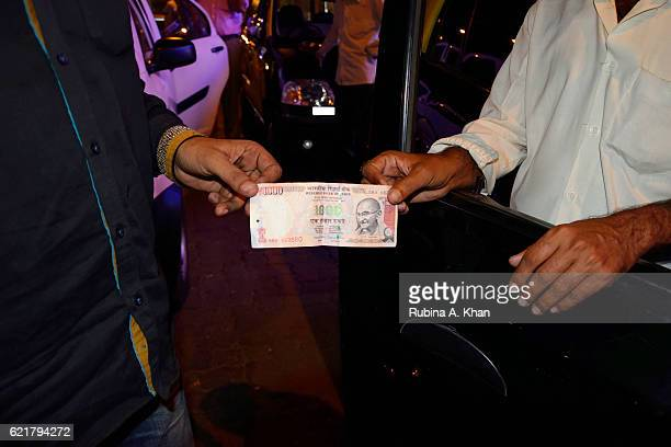 A closeup view of a 1000 Rupee note after India's Prime Minister Narendra Modi announced the discontinuation of 500 and 1000 Rupee currency notes as...