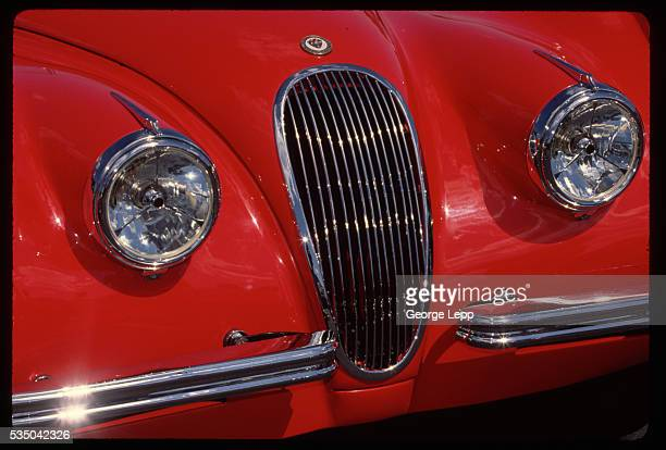 Closeup view of a 1954 XK120 Jaguar grill and headlamps