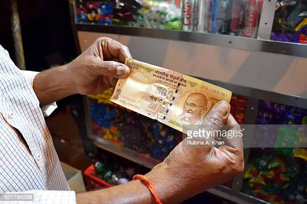 A closeup view of a 500 Rupee note after India's Prime Minister Narendra Modi announced the discontinuation of 500 and 1000 Rupee currency notes as...