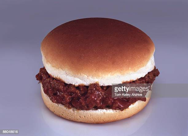 Close-up view of a sloppy joe sandwich, ca.1970s. A sloppy joe sandwich is typically made of ground beef, tomato sauce, and onions, served on a bun.