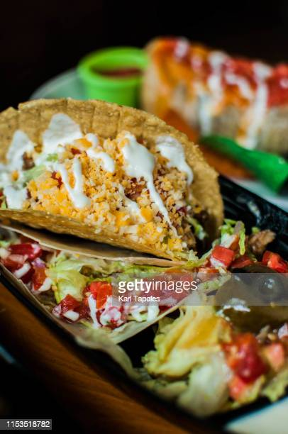 a close-up view of a soft and hard-shelled mexican taco - capital region stock pictures, royalty-free photos & images