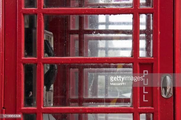 """close-up view of a typical uk red telephone booth with detail of the handle and the word """"pull"""" - telephone box stock pictures, royalty-free photos & images"""
