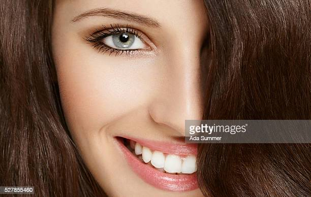 close-up view of a woman with a big smile
