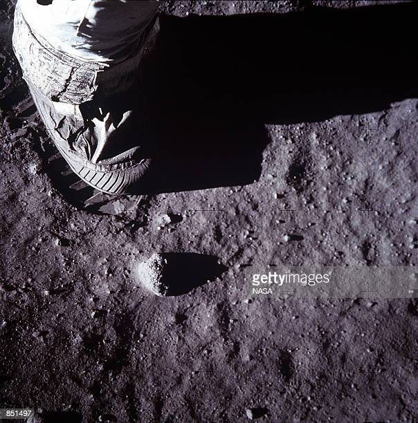 A closeup view of an astronaut's foot and foot print in the lunar soil is photographed with a 70mm lunar surface camera July 20 1969 during the...