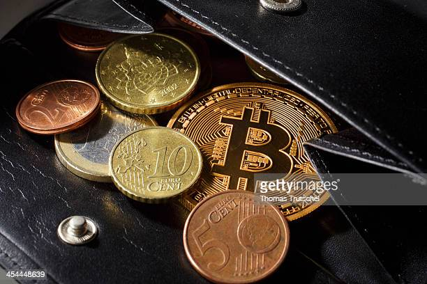 A closeup view of an illustration model of a Bitcoin is seen in a wallet with different Euro Coins on December 6 2013 in Berlin Germany Central...