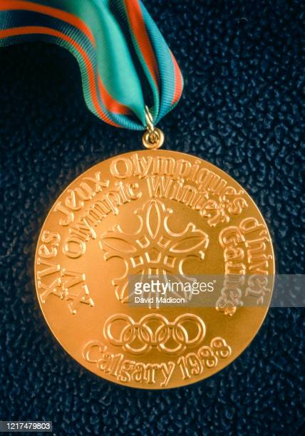A closeup view of an Olympic gold medal awarded during the 1988 Olympic Games held in Calgary Canada