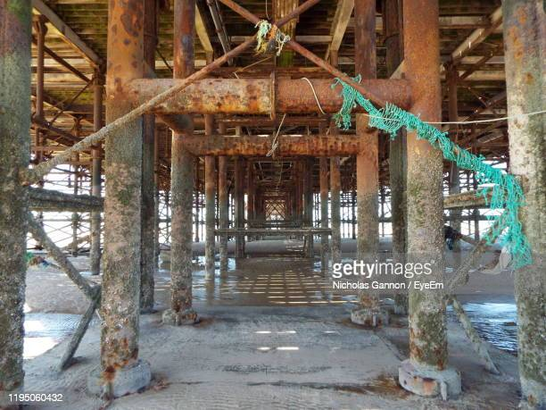 close-up view of beneath pier - blackpool beach stock pictures, royalty-free photos & images