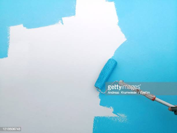 close-up view of blue wall - paint roller stock pictures, royalty-free photos & images