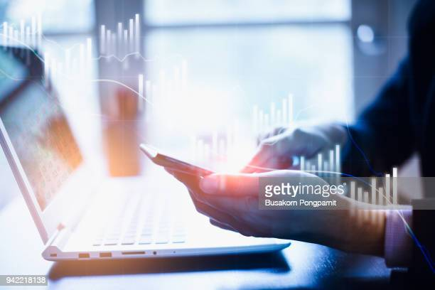 Closeup view of businessman hand touching on smartphone. concept of digital diagram,graph interfaces,virtual screen,connections icon.blurred