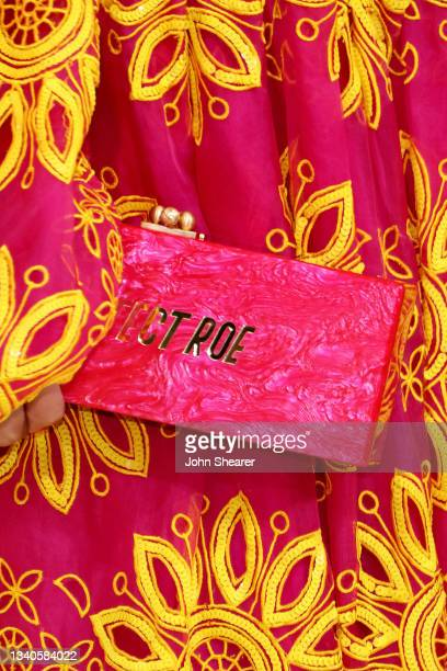 """Close-up view of clutch reading """"Protect Roe"""" worn by Teen Vogue Editor in Chief Versha Sharma at The 2021 Met Gala Celebrating In America: A Lexicon..."""