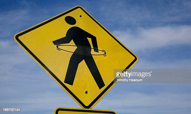 close-up view of cross walk sign with hula hoop - パホア ストックフォトと画像