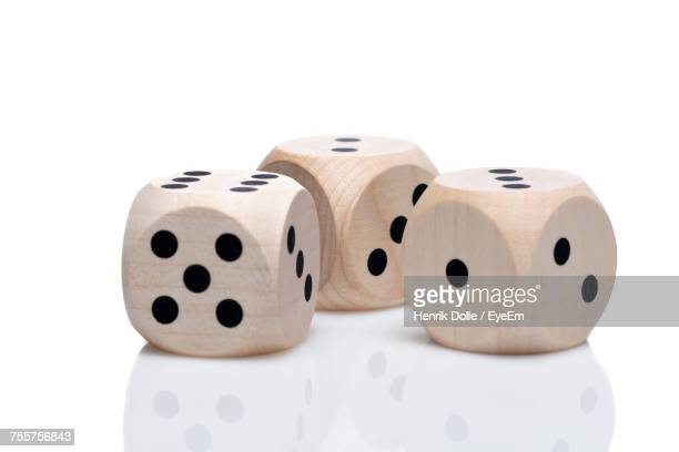 Close-Up View Of Dices Over White Background