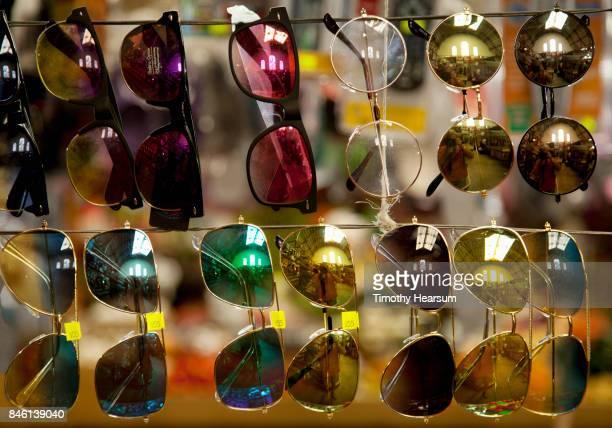 close-up view of display of sunglasses at a market - timothy hearsum imagens e fotografias de stock
