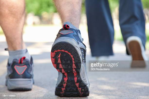 Closeup View of Exercisers Walking