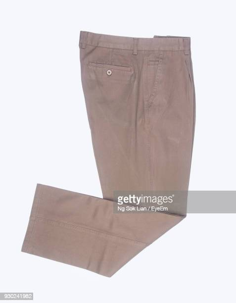 Close-Up View Of Formal Pant Over White Background