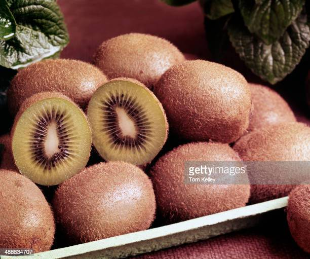 Closeup view of fresh kiwi fruit one of which has been cut in half 1994