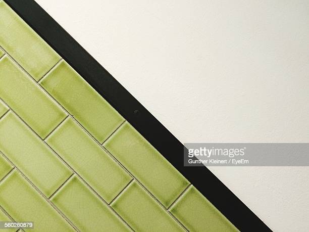 Close-Up View Of Green Tiles On Wall