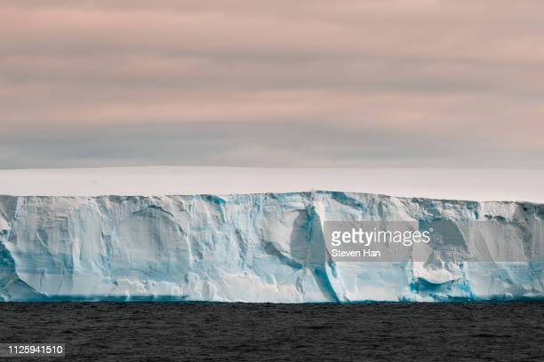close-up view of iceberg at dusk in the antarctica - 南極大陸探検 ストックフォトと画像