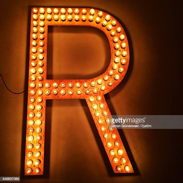 close-up view of illuminated neon - neon letters stock photos and pictures