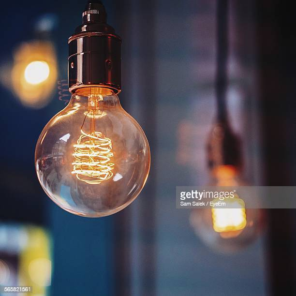close-up view of light bulb - light bulb stock pictures, royalty-free photos & images