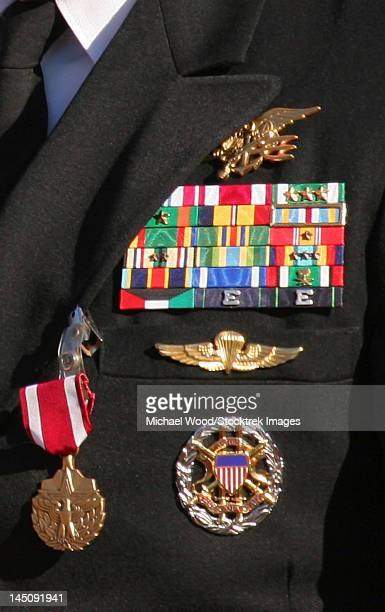 close-up view of military decorations and honors on a commander's dress uniform. - us military emblems stock pictures, royalty-free photos & images