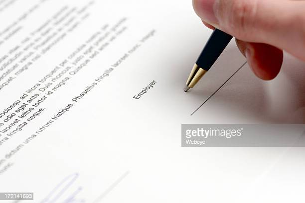 Closeup view of person signing a contract