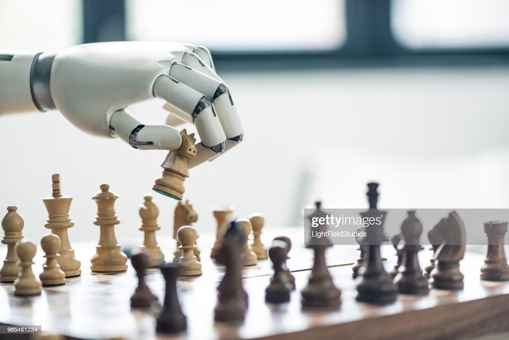 close-up view of robot playing chess, selective focus : Stock Photo