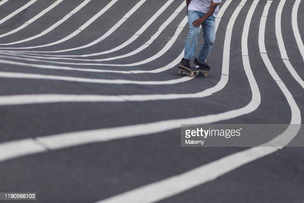 close-up view of skateboarder at superkilen park in copenhagen, denmark. - draft sports stock pictures, royalty-free photos & images