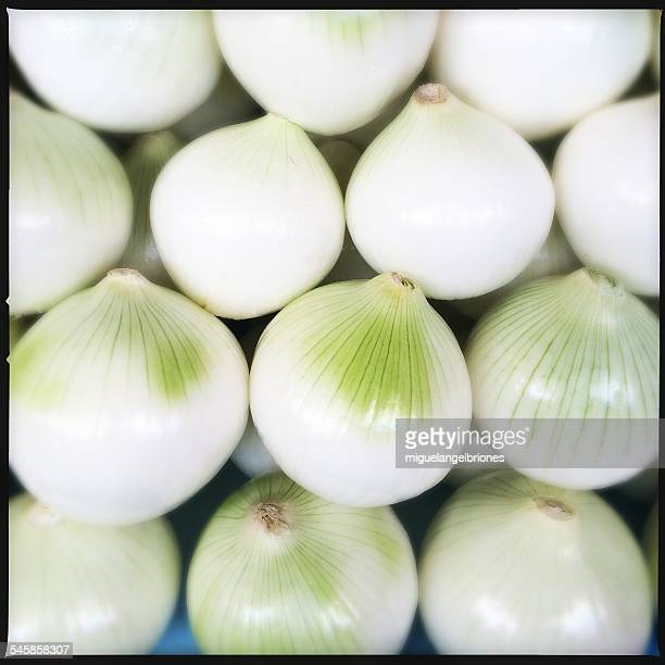 Close-up view of stack of onions