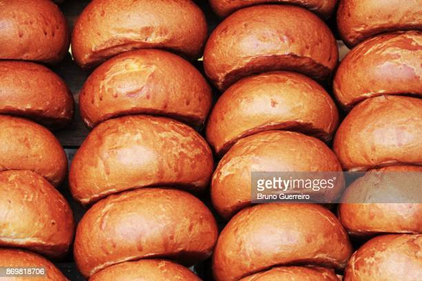 close-up view of stacked brioche buns - brioche stock pictures, royalty-free photos & images