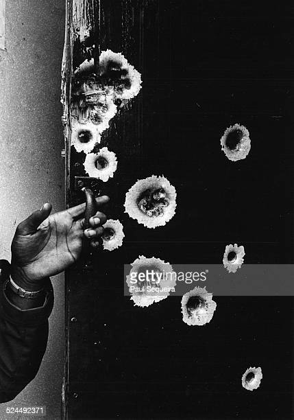 Closeup view of the bullet riddled front door at 2350 West Madison Street where Fred Hampton lived and which the FBI and Chicago police raided...