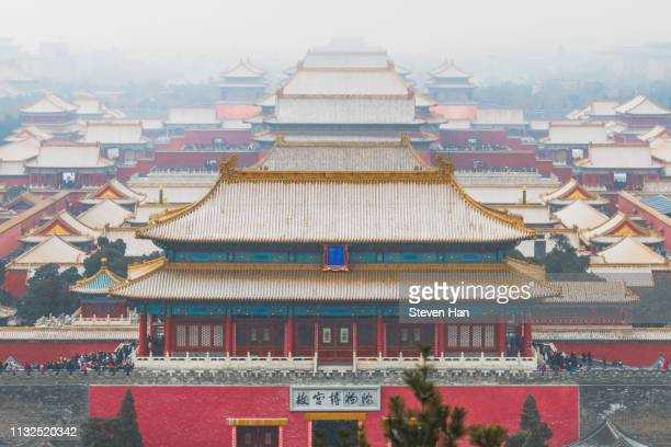 close-up view of the forbidden city in heavy snow - qing dynasty stock photos and pictures