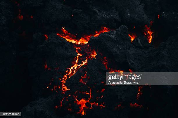 close-up view of the fresh melting burning lava at fagradalsfjall volcano eruption site, iceland - extreme close up stock pictures, royalty-free photos & images