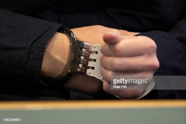 Close-up view of the handcuffs worn by Stephan Balliet as he sits in the courtroom on the fourth day of his trial on July 29, 2020 in Magdeburg,...