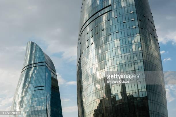 closeup view of the iconic flame towers, baku, azerbaijan - baku stock pictures, royalty-free photos & images