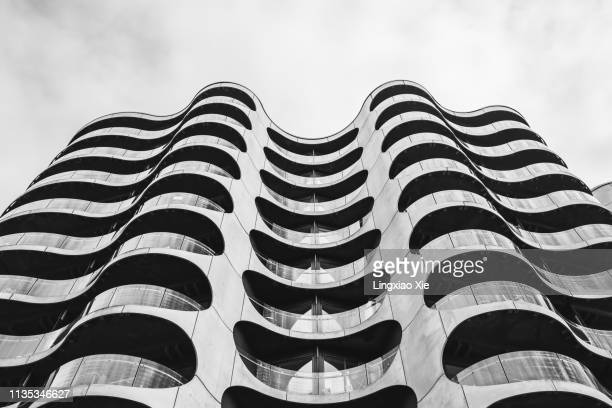 close-up view of the metropolis apartment building at sluseholmen in copenhagen, denmark - architecture stock pictures, royalty-free photos & images
