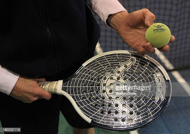 A closeup view of the paddle tennis racquet and ball as people play Paddle Tennis at Essex Country Club