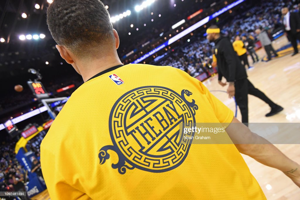 info for cac49 a1e28 A close-up view of the warm-up jersey of Stephen Curry of ...