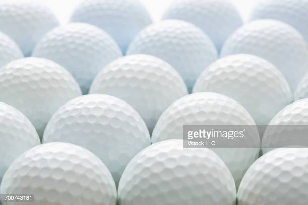 close-up view of white golf balls - golf background stock photos and pictures