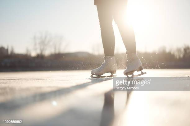 closeup view of woman ice-skates and ice - beige shoe stock pictures, royalty-free photos & images