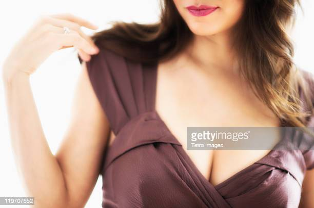 Close-up view of young woman's cleavage