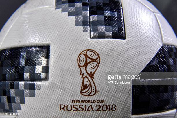 A closeup view shows the official match ball for the 2018 World Cup football tournament named 'Telstar 18' during its unveiling ceremony in Moscow on...