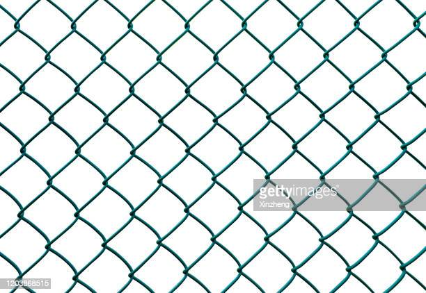 closeup wire fence aginst white background - chainlink fence stock pictures, royalty-free photos & images