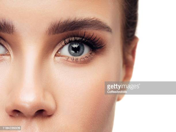 close-up woman face - eyelash stock pictures, royalty-free photos & images