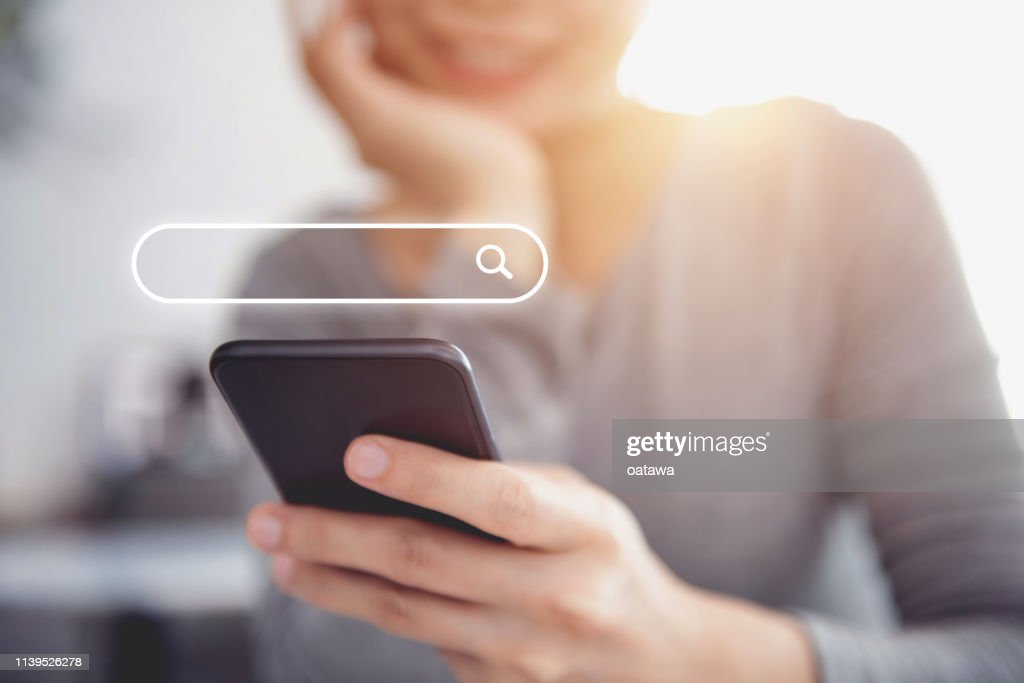 Closeup woman hands using mobile phone with Searching Browsing Internet Data Information Networking Concept. : Stock Photo