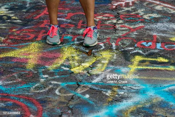 close-up woman wearing pink shoelaces on spray painted road. - centralia pennsylvania foto e immagini stock