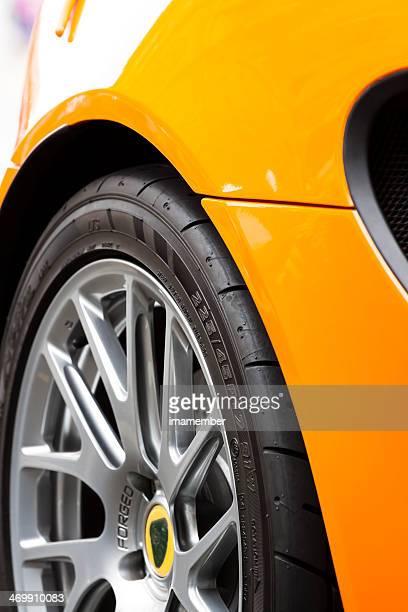 Closeup yellow Lotus car alloy wheel