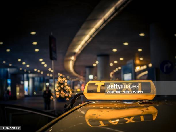 close-up yellow taxi on street at night - yellow taxi stock pictures, royalty-free photos & images